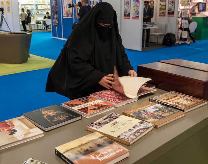 A niqab wearing visitor browses books in Indonesia stand at the the 67th Frankfurt Book Fair, in Frankfurt, Germany, 14 Octob
