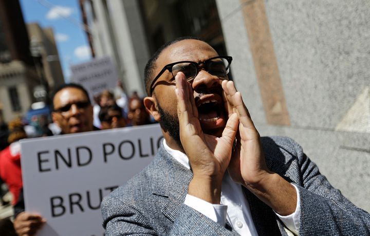 Melech Thomas chants during a demonstration outside the State Attorney's office calling for the investigation into the death