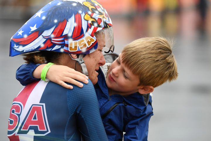 Kristin Armstrong hugs her 5-year-old son after winningthe gold medal in the women's cycling road individual time trial