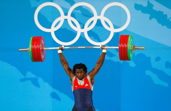 Kendrick Farris of the United States competes in the 85kg weightlifting event at the Beijing University of Aeronautics &