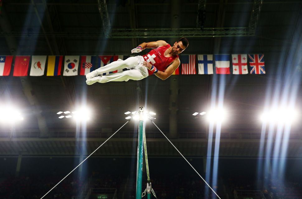 Oliver Hegi of Switzerland competes on the horizontal bar in the Artistic Gymnastics Men's Team qualification on Day 1 of the