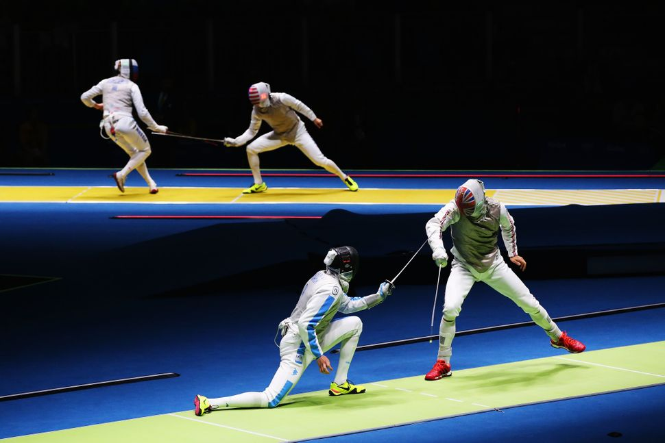 Richard Kruse (R) of Great Britain defeats Andrea Cassara (L) of Italy during Men's Individual Foil on Day 2 of the Rio 2016