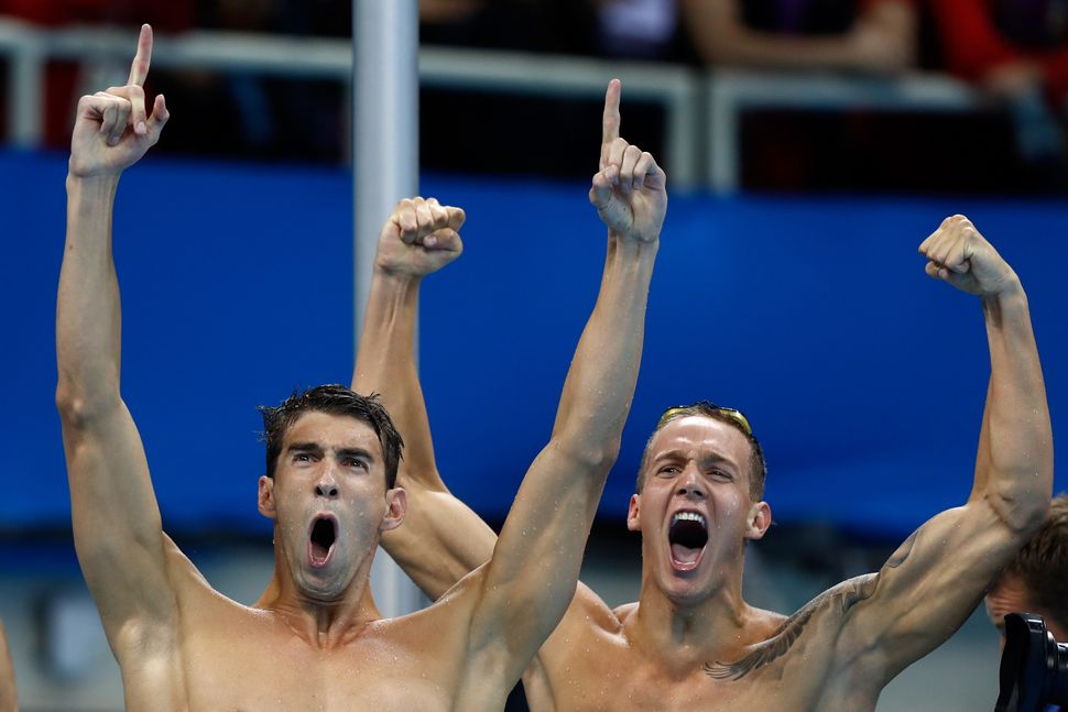 Michael Phelps and Caeleb Dressel of the United States celebrate winning gold in the final of the Men's 4 x 100m Freestyle Re