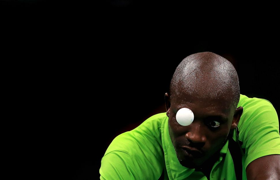 Segun Toriola of Nigeria plays a Men's Singles second round match against Koki Niwa of Japan on Day 2 of the Rio 2016 Olympic