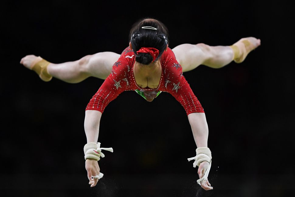 Jiaxin Tan of China competes on the uneven bars during Women's qualification for Artistic Gymnastics on Day 2 of the Rio 2016