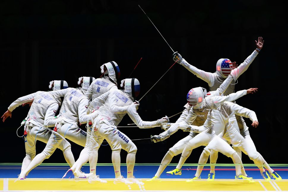 A multiple exposure image shows Alexander Massialas of the United States defeating Artur Akhmatkhuzin of Russia during M