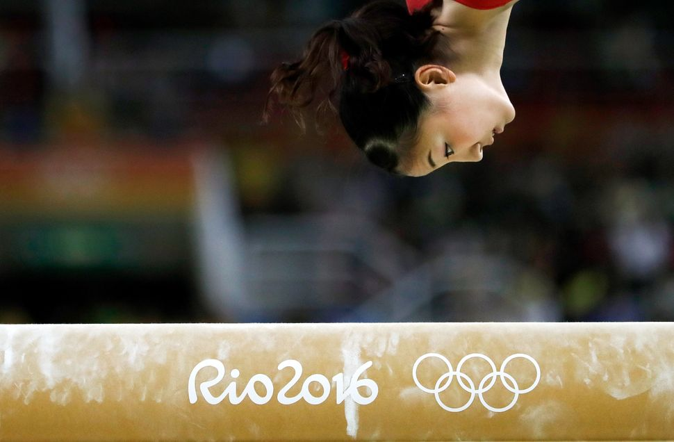 Asuka Teramoto of Japan competes on the balance beam during women's qualification for Artistic Gymnastics.