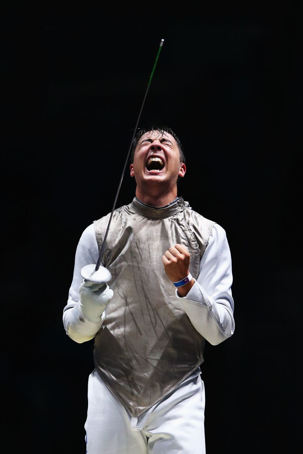 Alexander Massialas of the United States celebrates defeating Giorgio Avola of Italy during Men's Individual Foil on Day 2 of