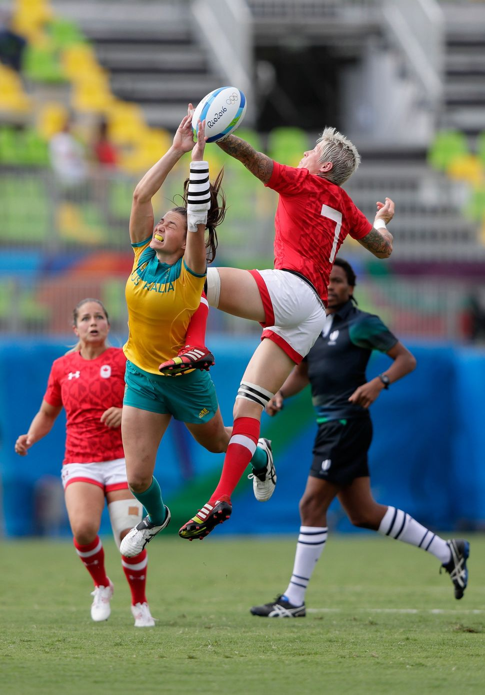 Jennifer Kish of Canada and Chloe Dalton of Australia go up for the ball during the Women's Semi Final 1 Rugby Sevens match b