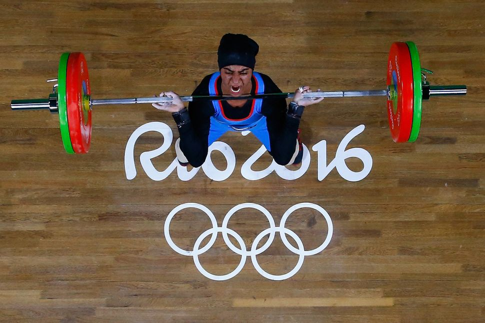 Ayesha Shahriyar M. Albalooshi of United Arab Emirates competes during the Women's 58kg Group B weightlifting contest on Day