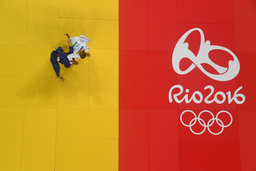 Hedvig Karakas of Hungary (in white) competes against Chen-Ling Lien of Chinese Taipei in the Women's 57 kg Repechage Judo co