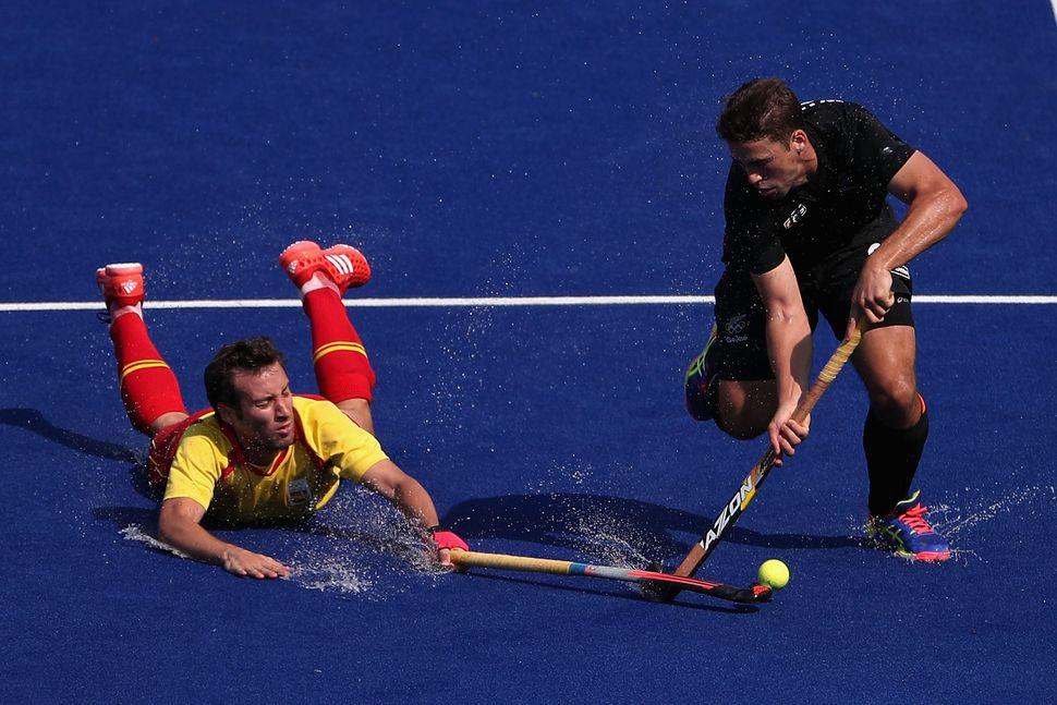 Nick Wilson #32 of New Zealand attempts a shot past Bosco Perez-Pla #5 of Spain during the hockey game on Day 4 of the Rio 20