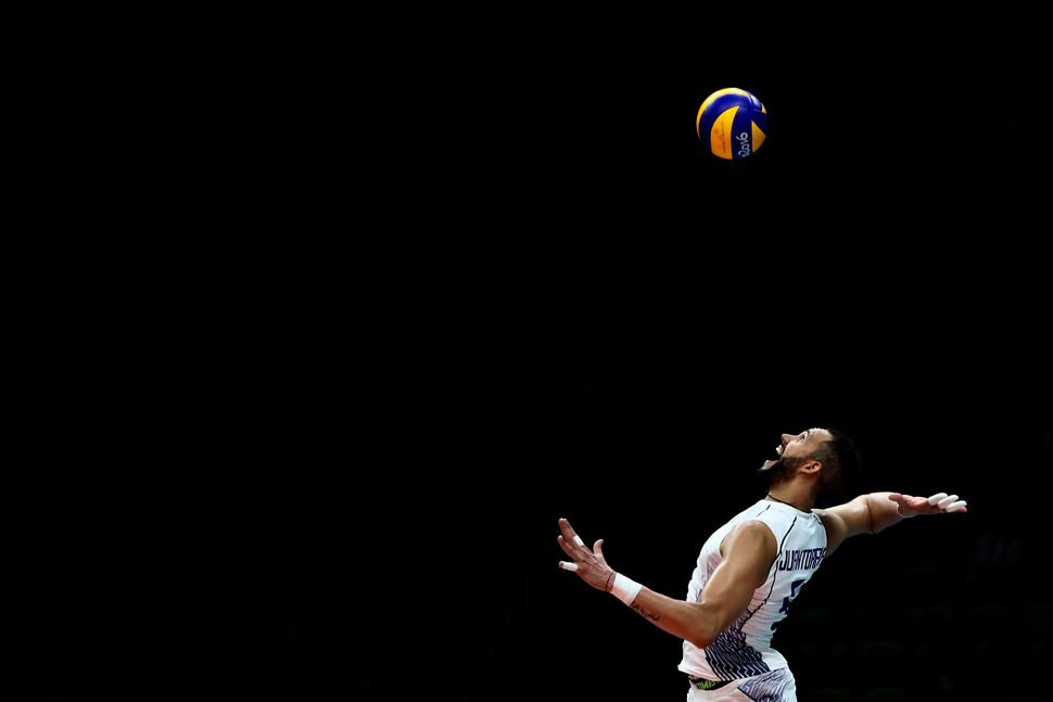 Osmany Juantorena #5 of Italy in action during the men's qualifying volleyball match between the United States and Italy on D