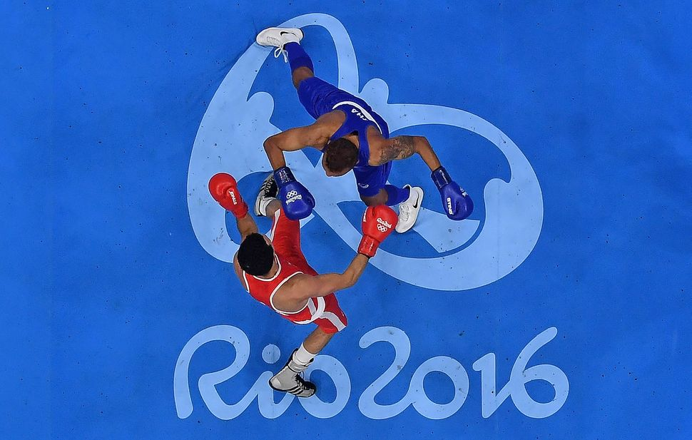 Enrico Lacruz of the Netherlands (blue) fights Otgondalai Dorjnyambuu of Mongolia (red) in their Mens Lightweight 60kg bout o