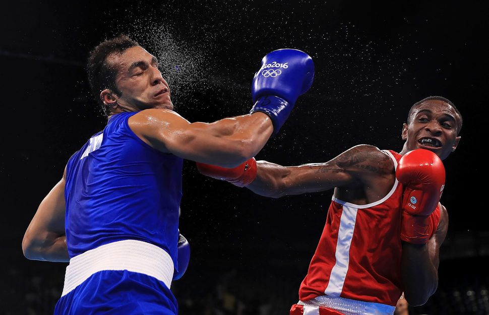Merven Clair of Mauritius (red) fights against Hosam Hussein Bakr Abdin of Egypt (blue) in their Men's Middleweight 75kg bout