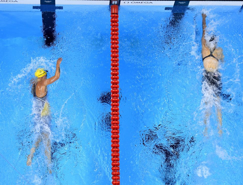 Katie Ledecky (R) of the United States wins gold ahead of Sarah Sjostrom of Sweden in the Women's 200m Freestyle Final on Day