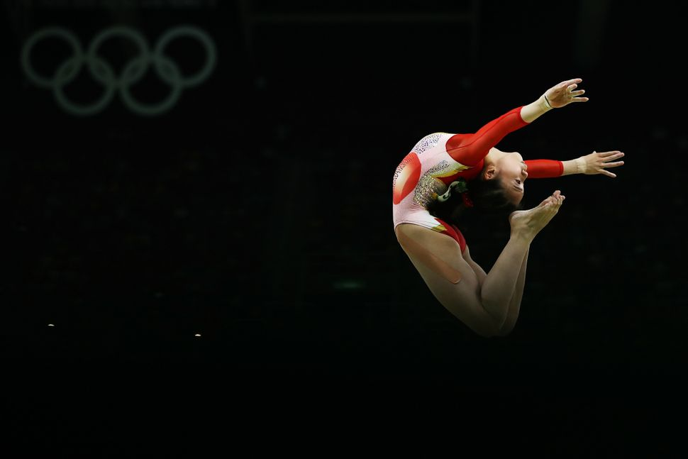 Aiko Sugihara of Japan competes on the balance beam during the Artistic Gymnastics Women's Team Final on Day 4 of the Rio 201