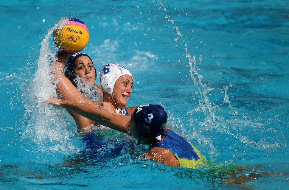 Rosaria Aiello of Italy shoots under pressure from Marina Zablith of Brazil during Water Polo Preliminary Round Group B match