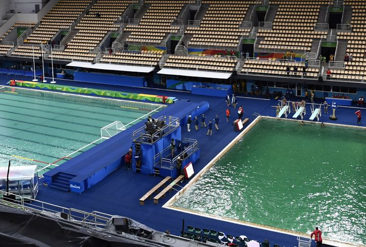 The Olympic water polo pool, at left, began turning green Wednesday.