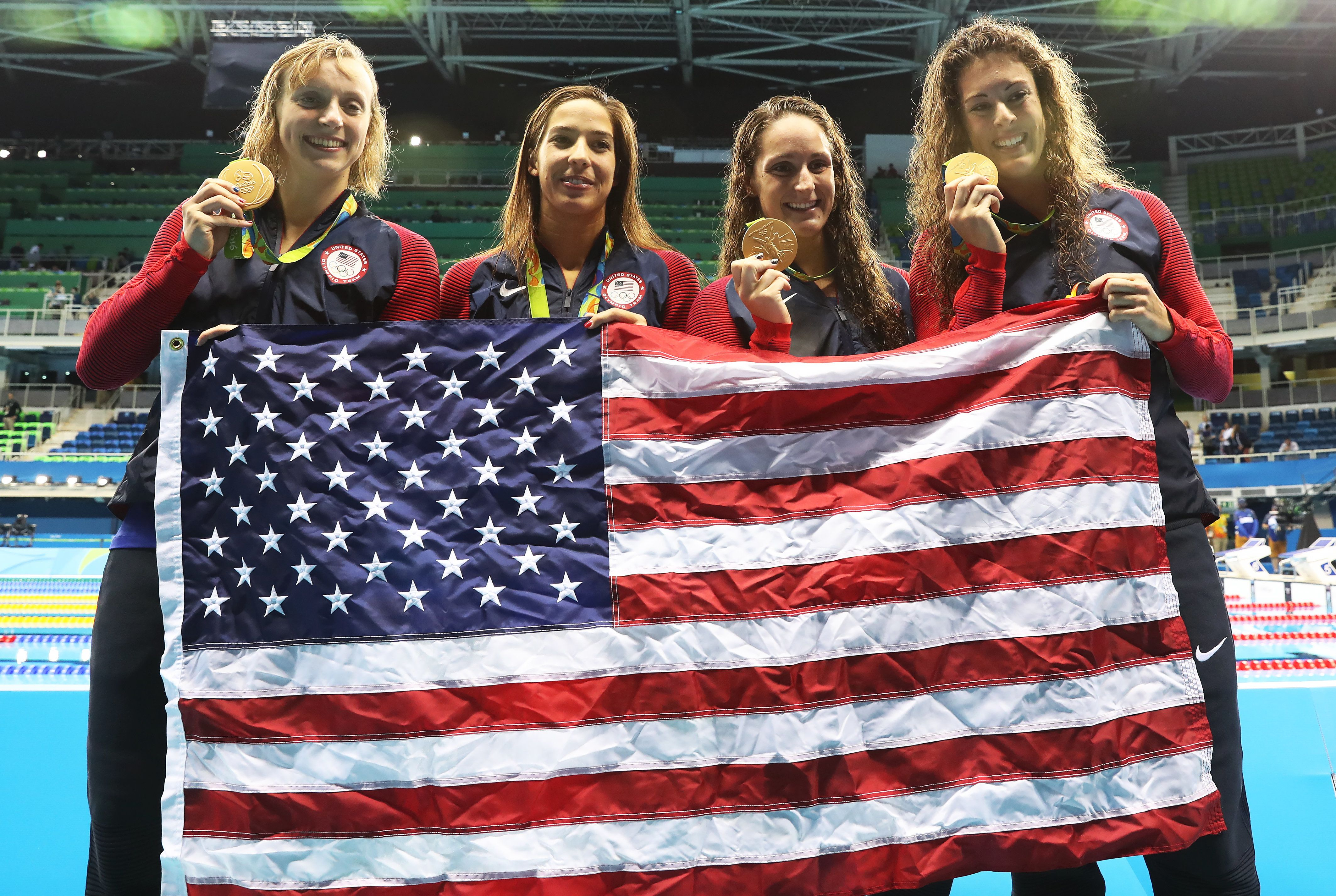 RIO DE JANEIRO, BRAZIL - AUGUST 10:  Katie Ledecky, Maya Dirado, Leah Smith and Allison Schimdt of United Statesvpose with their Gold medals from the Women's 4 x 20m Freestyle Relay on Day 5 of the Rio 2016 Olympic Games at the Olympic Aquatics Stadium on August 10, 2016 in Rio de Janeiro, Brazil. (Photo by Ian MacNicol/Getty Images)