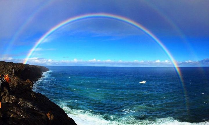 A rainbow formed over the ocean while Teal was paddling to the lava, as her parents watched from the cliffs above.