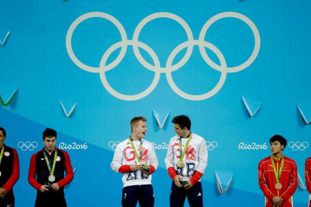 Britain's Jack Laugher, centre left, and Chris Mears, center right, react after being presented with...