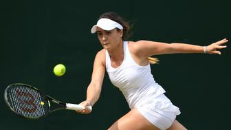 LONDON, ENGLAND - JULY 03:  Gabriella Taylor of Great Britain plays a forehand during the Girl's singles first round match against Morgan Coppoc of The United States on Middle Sunday of the Wimbledon Lawn Tennis Championships at the All England Lawn Tennis and Croquet Club on July 3, 2016 in London, England.  (Photo by Shaun Botterill/Getty Images)
