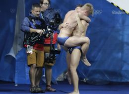MailOnline Scolded By LGBT Charity For Pointing Out Rio Divers' 'Manly Hug'