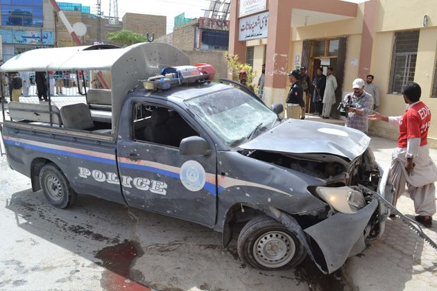 A damaged police car is seen after a blast near Al-Khair Hospital on Zarghoon Road in Quetta, Pakistan...
