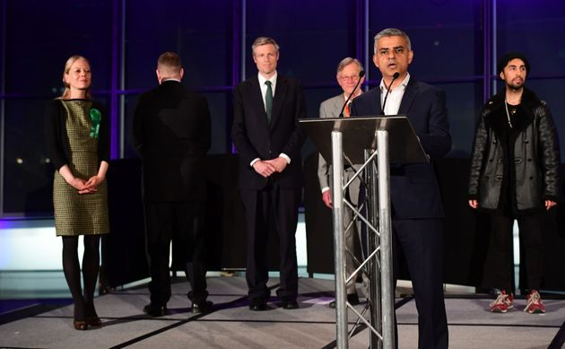 Britain First candidate Paul Golding (second left) turns his back as Sadiq Khan speaks onstage at...