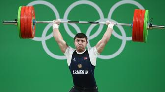 RIO DE JANEIRO, BRAZIL - AUGUST 10:  Andranik Karapetyan of Armenia lifts during the Men's 77kg Group A weightlifting contest on Day 5 of the Rio 2016 Olympic Games at Riocentro - Pavilion 2 on August 10, 2016 in Rio de Janeiro, Brazil.  (Photo by Julian Finney/Getty Images)