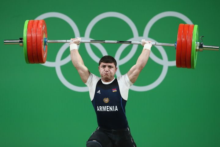 Armenian weightlifter Andranik Karapetyan was in contention for a medal before his elbow gave way.