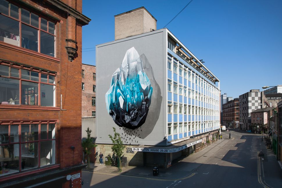 """Inhuman barriers"" mural painting that addresses the theme of immigration realized for ""Cities of hope"" in Manche"