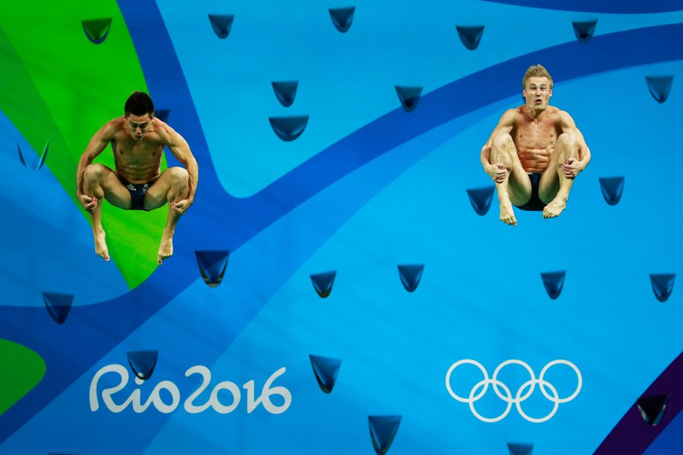 Jack Laugher and Chris Mears of Great Britain compete in the Men's Diving Synchronised 3m Springboard Final on Day 5.