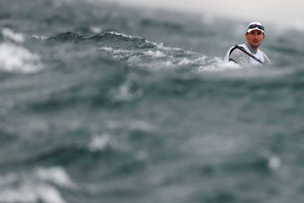 Giles Scott of Great Britain competes in the Men's Finn class on Day 5.