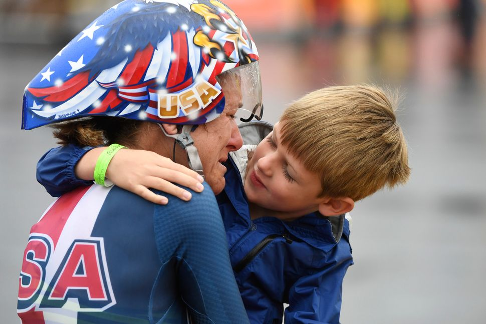 Kristin Armstrong hugs her son Lucas Armstrong Savola, 5, after she won the gold medal in the women's cycling road individual