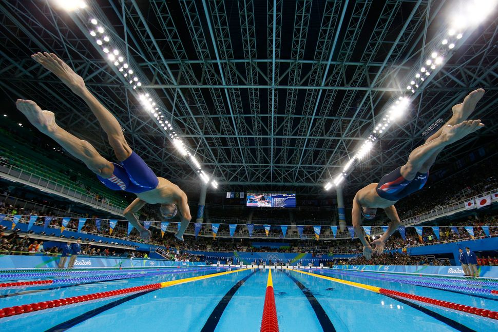 Michael Phelps and Ryan Lochte of the United States compete in the second semifinal of the Men's 200m Individual Medley on Da