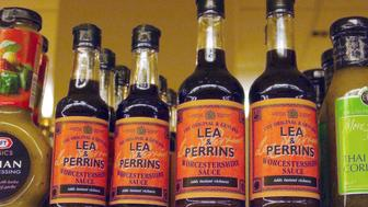 UNITED KINGDOM - JUNE 20:  Bottles of Lee & Perrins Worcestershire sauce seen in a supermarket in Kensington, London, U.K., Monday June 20, 2005. H.J. Heinz Co., the world's largest ketchup maker, agreed to buy most of HP Foods from Groupe Danone for 470 million pounds ($855 million) to become the U.K.'s biggest seller of sauces and gain brands include Lea & Perrins.  (Photo by Andy Shaw/Bloomberg via Getty Images)