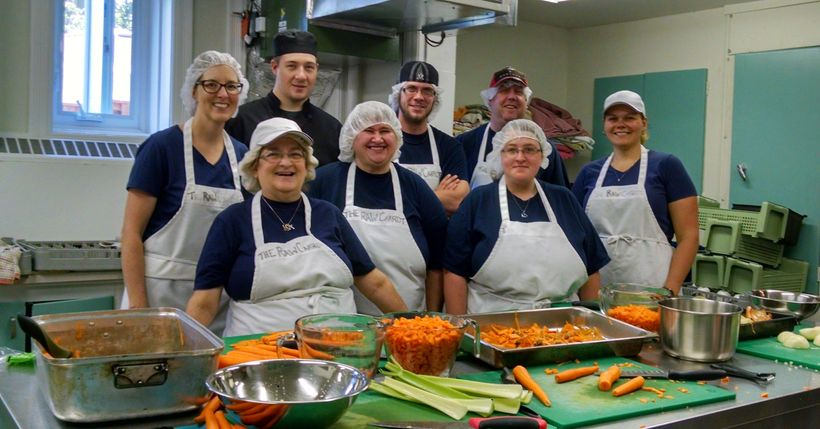 Staff and volunteers in the kitchen of The Raw Carrot Soup Enterprise, Paris, Ontario, Canada.