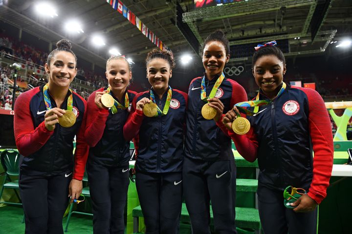 Americangymnasts Aly Raisman, Madison Kocian, Lauren Hernandez, Gabrielle Douglas and Simone Biles pose with their meda