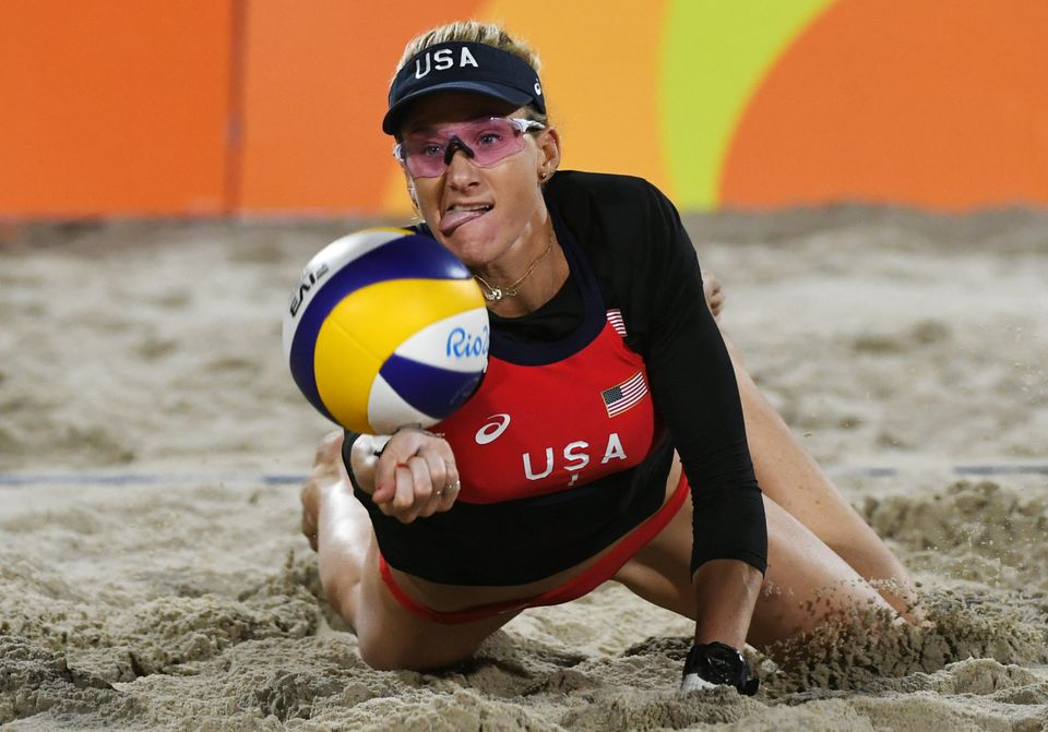 USA's Kerri Walsh Jennings dives for a dig during the women's beach volleyball qualifying match between the USA and Switzerla
