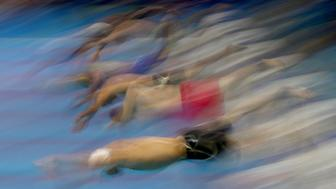 RIO DE JANEIRO, BRAZIL - AUGUST 11:  Competitors dive into the water in heat five of the Men's 50m Freestyle on Day 6 of the Rio 2016 Olympic Games at the Olympic Aquatics Stadium on August 11, 2016 in Rio de Janeiro, Brazil.  (Photo by Elsa/Getty Images)