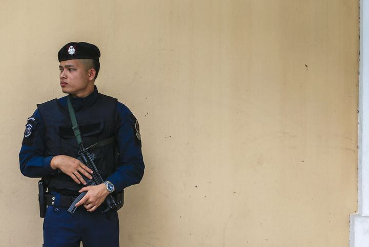 A police officer stands guard outside the Russian Embassy in Bangkok, Thailand, December 4, 2015.