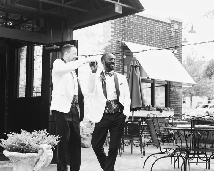 Eric and David take a moment to dance outside in the sun after celebrating their wedding together.