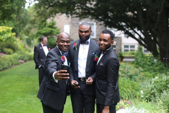 Groomsmen pose for a selfie before we head back to the reception.
