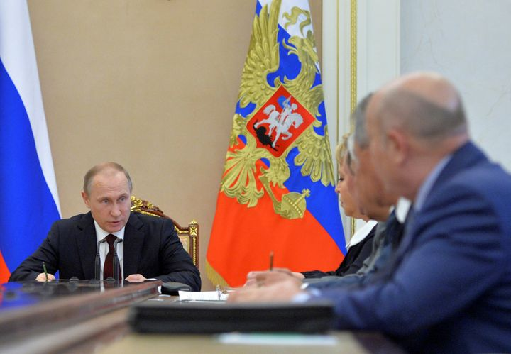 Russian President Vladimir Putin chairs a meeting with members of the Security Council at the Kremlin in Moscow, Russia, July