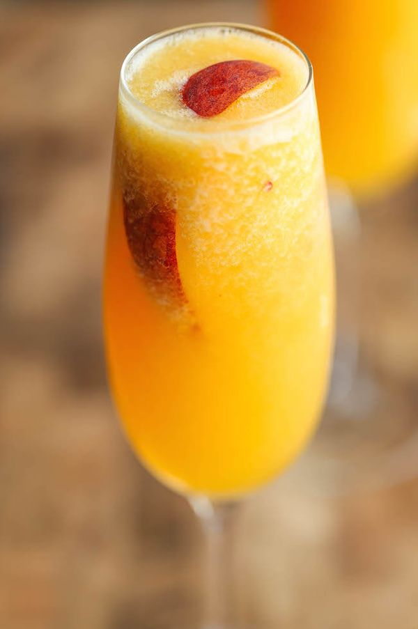 "<strong>Get the <a href=""http://damndelicious.net/2015/05/29/frozen-peach-bellini/"" target=""_blank"">Frozen Peach Bellini reci"