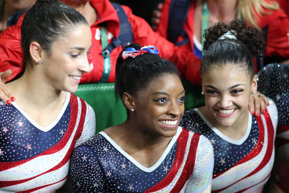 Gymnastics - Olympics: Day 4  Simone Biles, (center), of the United States with team mates Alexandra Raisman, (left) and Madi