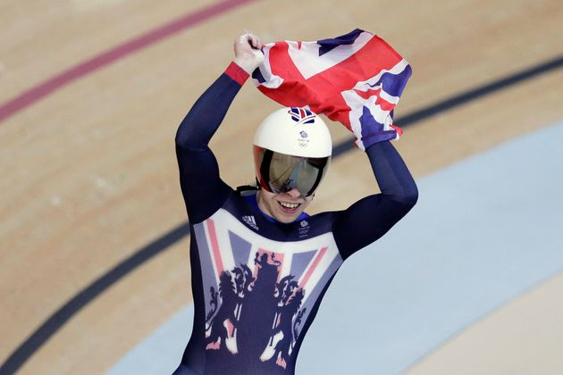 Philip Hindes of Great Britain celebrates after winning gold in the men's team sprint finals at the Rio...