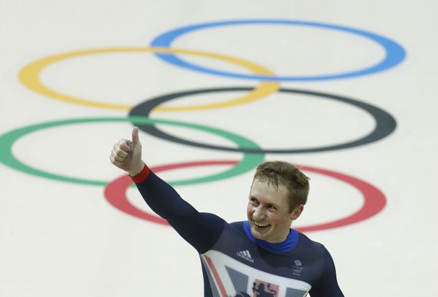Britain's Jason Kenny gives a thumbs up as he celebrates after winning gold in the men's Team Sprint...